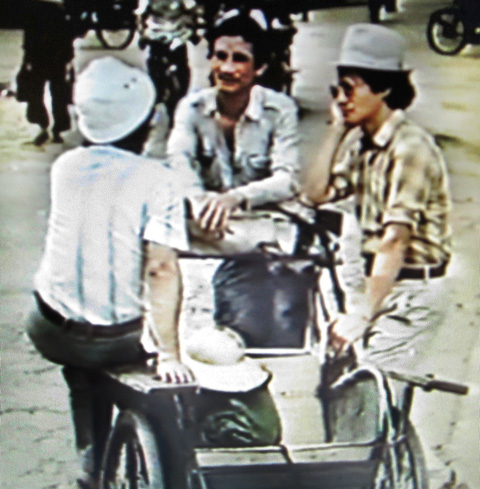 Three men with a bike taxi.